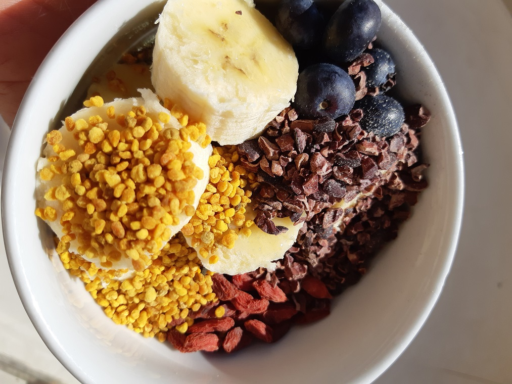 A typical #raw vegan day in Algarve Portugal in February raw vegan dessert goji berries bee pollen and cacao nibs